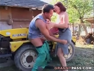 German Granny Rides Young Dick Outdoor